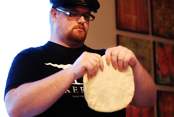 Troy kneading the dough.