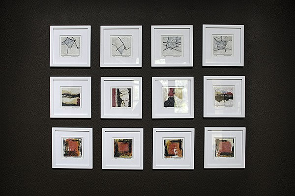 a grid display of mini encaustic paintings